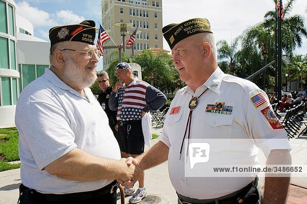 Florida  Miami Beach  Miami Beach Police Station  Memorial Day Ceremony  federal holiday  remember  honor  war veteran  military  man  men  shaking hands  greeting  overweight  beard  belly
