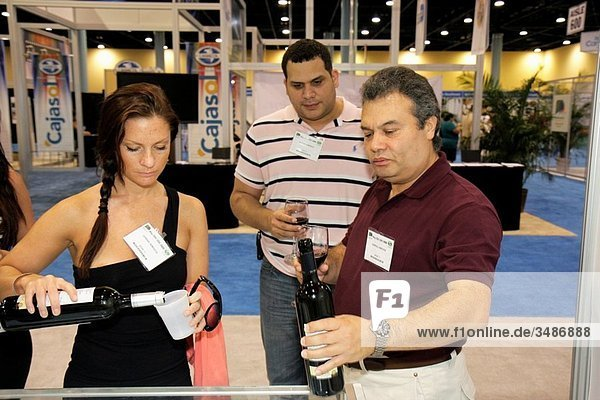 Florida  Miami Beach  Miami Beach Convention Center  centre  Mediterranean Experience Trade Fair  exhibitor  import  export  international commerce  marketing  distributor  wine  tasting  Hispanic  man  woman  pour