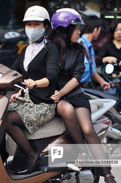 Hanoi (Vietnam): girls on a motor-bike
