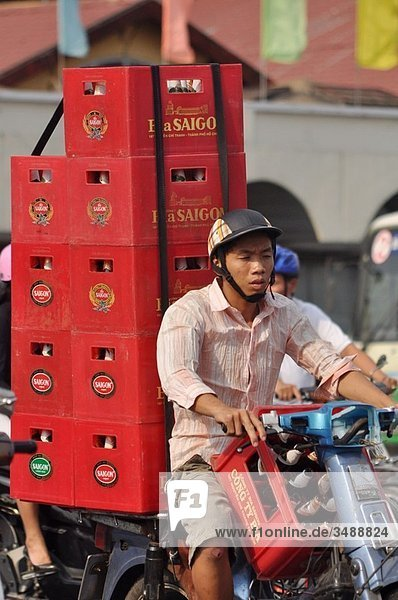 Ho Chi Min City (Vietnam): a man carrying many Saigon Beer boxes on his motor-bike