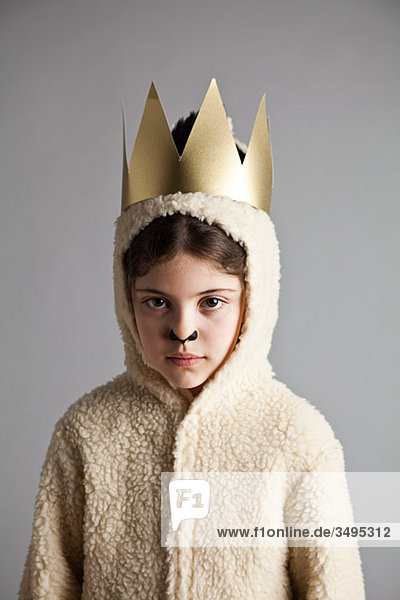 Young girl dressed up as sheep  wearing gold crown