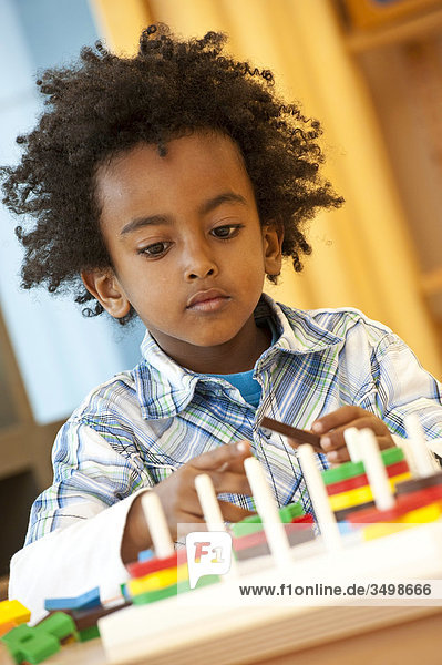 Young boy playing with toys  portrait