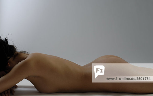 ea28448c2b2b Naked young woman lying face down 26174 - Emotive - Royalty Free ...