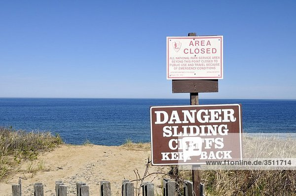 Erosion at Cape Cod National Seashore warning sign on cliff at Nauset Light Beach  Eastham