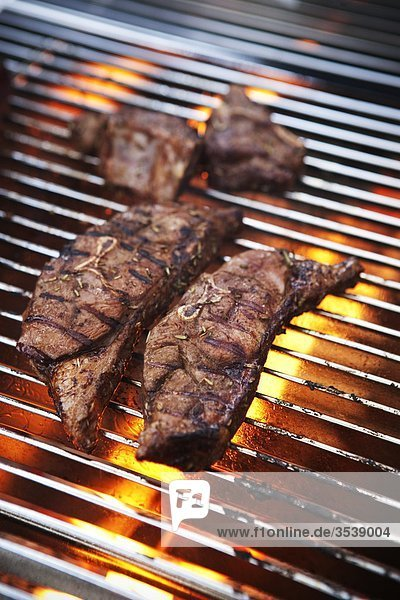 Meat cooked on barbecue grill