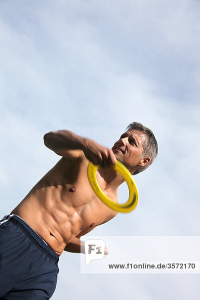 Man throwing frisbee outdoors