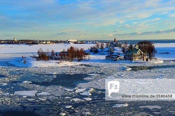 Icy Baltic sea around Helsinki  with Finnish houses on islands