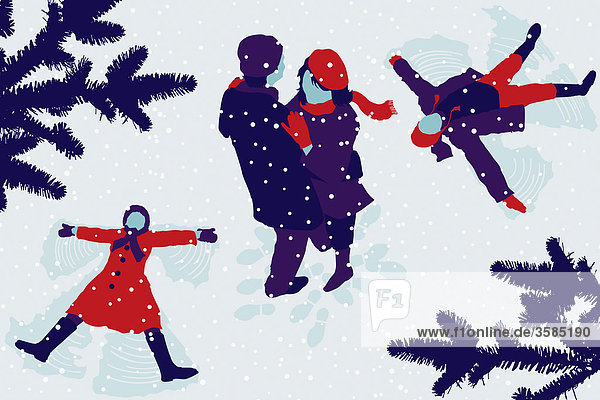 Couple hugging and children making snow angels