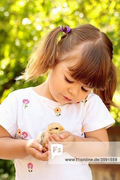 Little girl with chick Little girl with chick