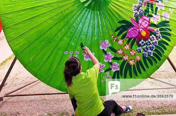 Umbrella making  Bo Sang umbrella village  near Chiang Mai  Northern Thailand