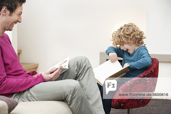 Man and his son reading books