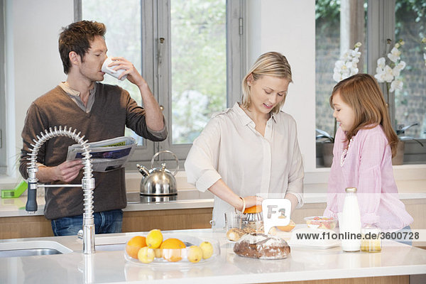 Family preparing breakfast in the kitchen