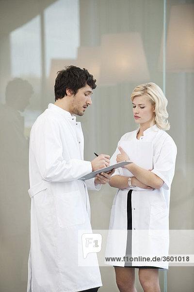 Doctors examining a medical report