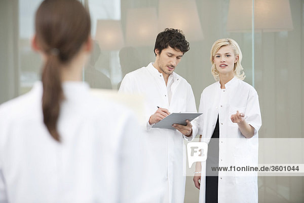Doctor discussing with her colleague