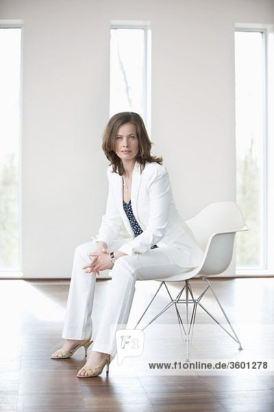 Businesswoman sitting in a waiting room