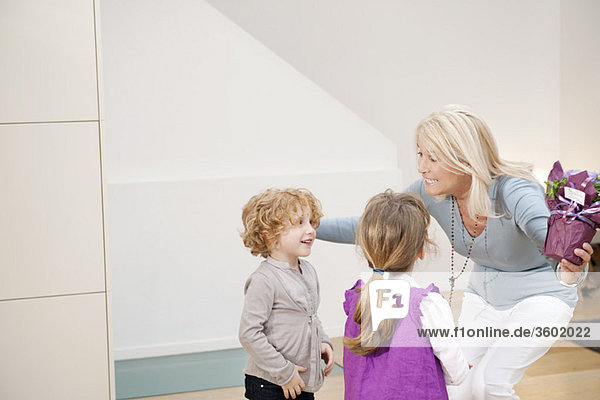 Woman greeting her grandchildren