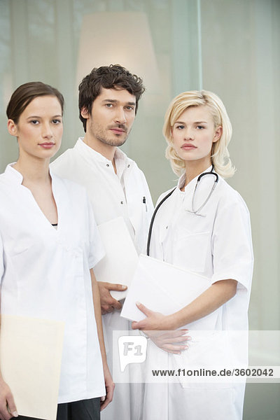 Portrait of three doctors standing together