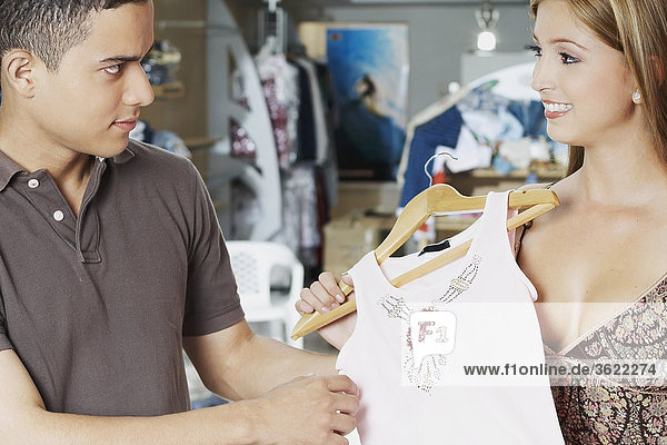 Close-up of a young couple choosing clothes in a store