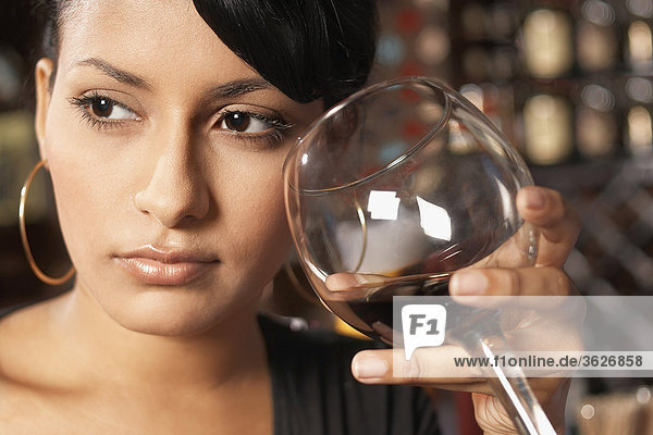 Close-up of a young woman holding a glass of wine