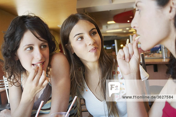Close-up of three young women in a restaurant