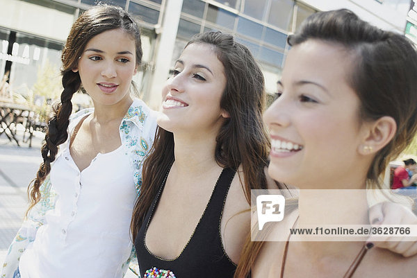 Close-up of three young women smiling