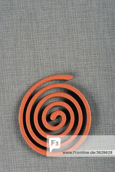 High angle view of an insect repellant coil