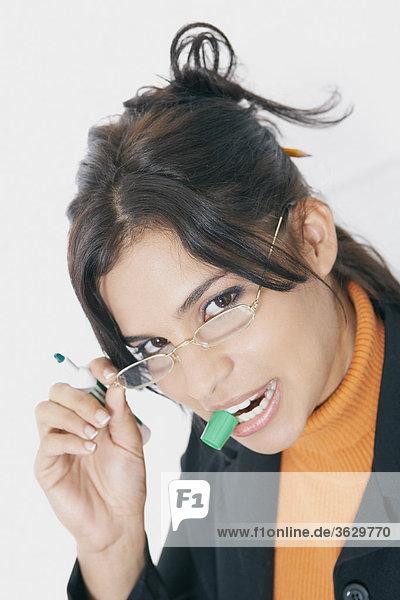 Portrait of a businesswoman adjusting her eyeglasses