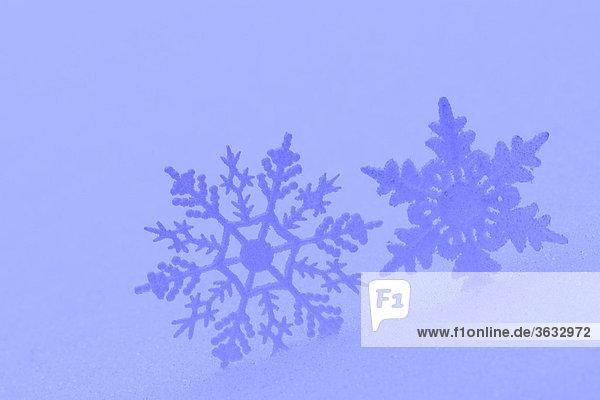 Decorative snowflake in the snow
