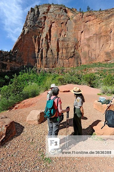 Visitors Talk with Female Ranger Big Bend Area Mount Zion National Park Utah