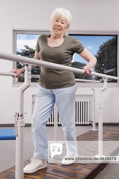 Disabled woman practicing on a walker