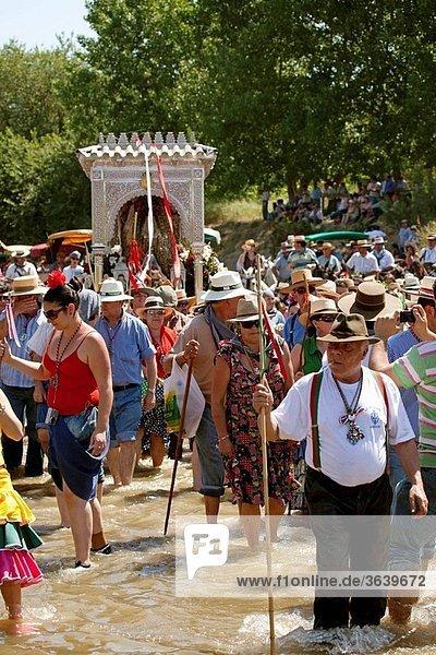Pilgrims crossing Quema river on their way to El Rocio  Villamanrique de la Condesa  Sevilla province  Andalusia  Spain