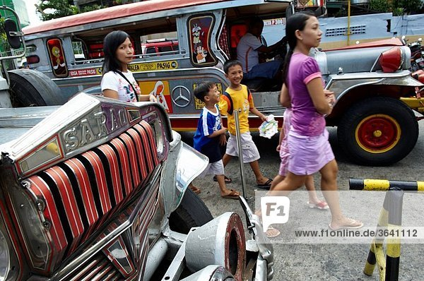 Filipino people walk trough jeepneys  the most popular transportation vehichle in the philippines Mandaluyong City Metro Manila Philippines