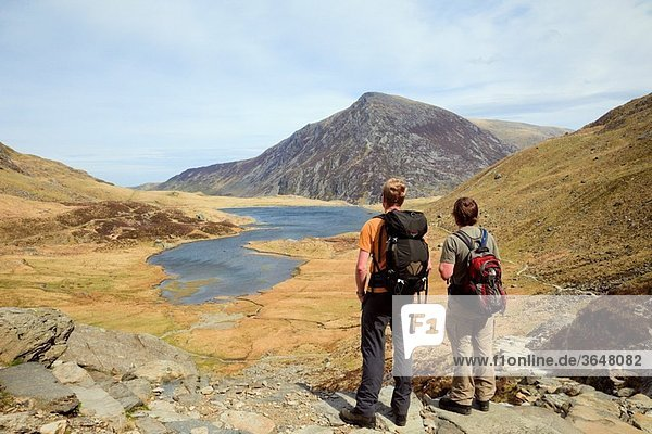 Cwm Idwal  Gwynedd  North Wales  UK  Europe Walkers by Llyn Idwal in the mountains of Snowdonia National Park