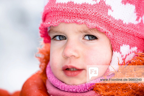 Little girl with a wool cap