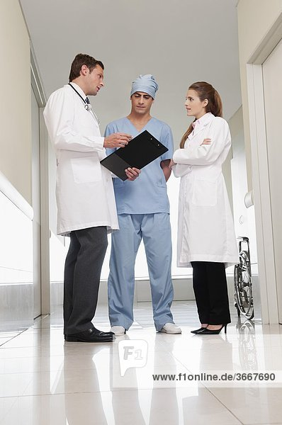Three doctors discussing in a hospital