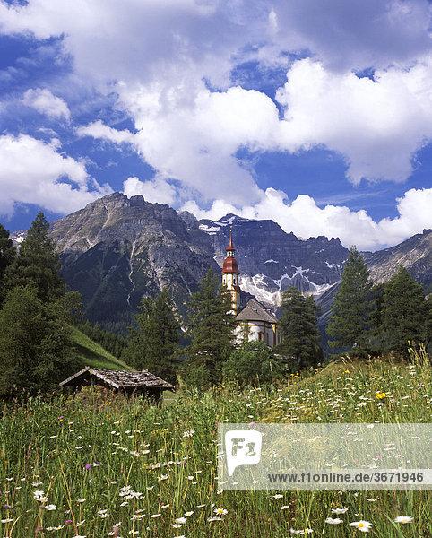 Obernberger Tal Obernberger valley side valley of Wipptal Tyrol Austria parish church S. Nikolaus in front of Kleiner Tribulaun and Schwarzer Wandspitze