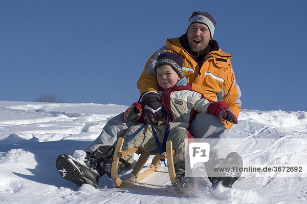 Familiy in the winter sleigh sledging on a sledge