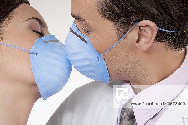 Doctors wearing flu masks and romancing