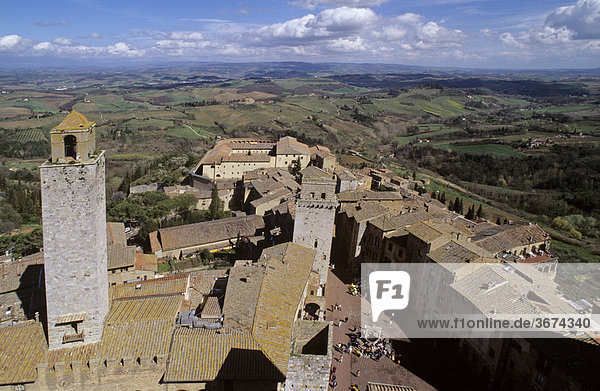 View from bell tower to place Piazza della Cisterna below in San Gimignano Tuscany Italy