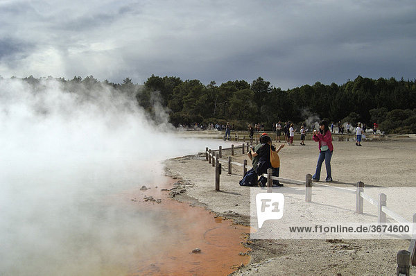 Tourists at Champagne Pool in Wai o Tapu New Zealand