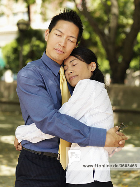 An affectionate businessman and businesswoman
