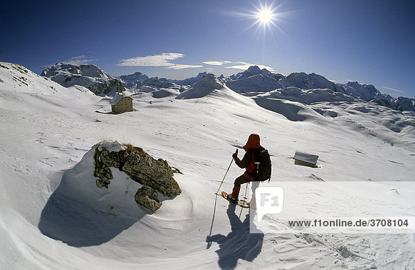 Woman on a snow shoe tour  above the Seekofel cabin  Pragser Dolomites  Italy  Europe