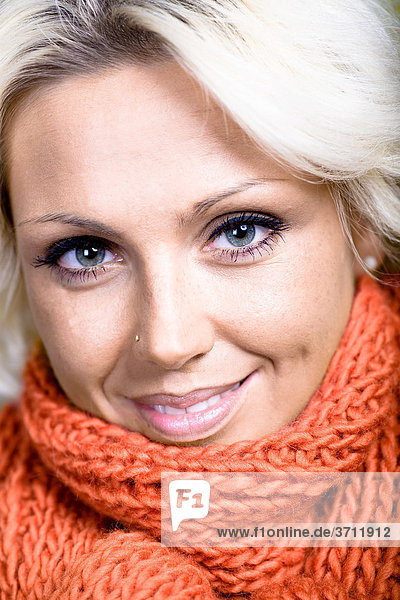 Young woman with a wool scarf  portrait