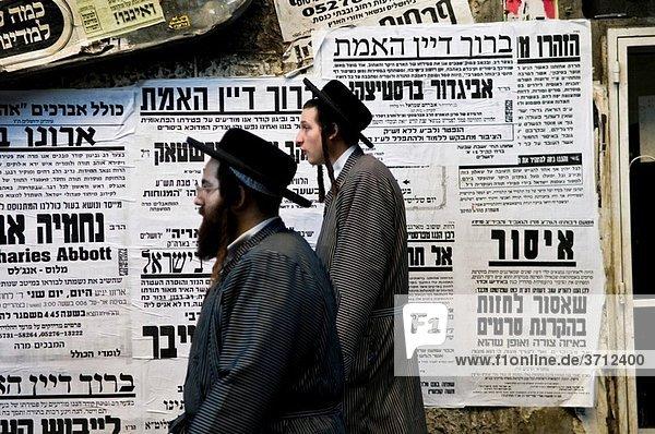 Hasidic men walking in Mea Shearim neighborhood in Jerusalem.