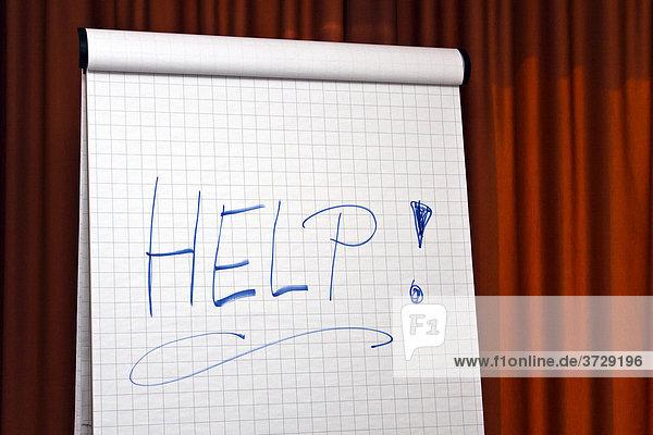 Flipchart mit dem Wort Help