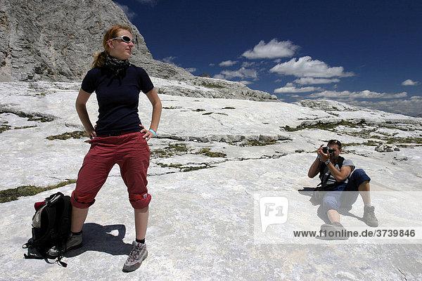 Man taking a picture of female hiker  Tondi di Sorapiss  Dolomites  Alps  Italy  Europe