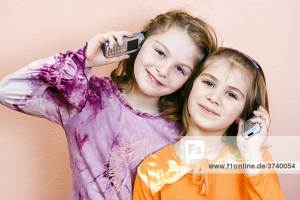 Two little girls  9 and 6 years old  on the phone