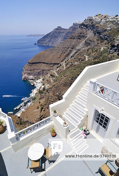 View over a sun terrace and the town of Thira  Fira  on a crater's edge with typical Cycladic architecture  Santorini  Cyclades  Greece  Europe