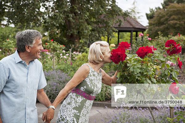 Mature couple in rose garden