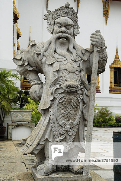 Fearsome guard of stone at the King¥s Grand Palace Bangkok  Thailand